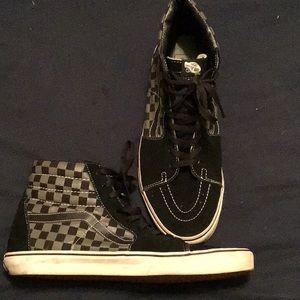 Men's classic checkerboard Vans high tops.